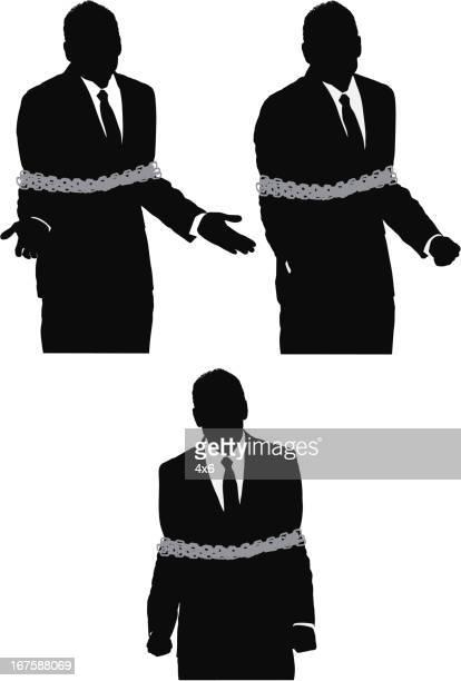 Silhouette der Geschäftsmann gebunden mit Kette