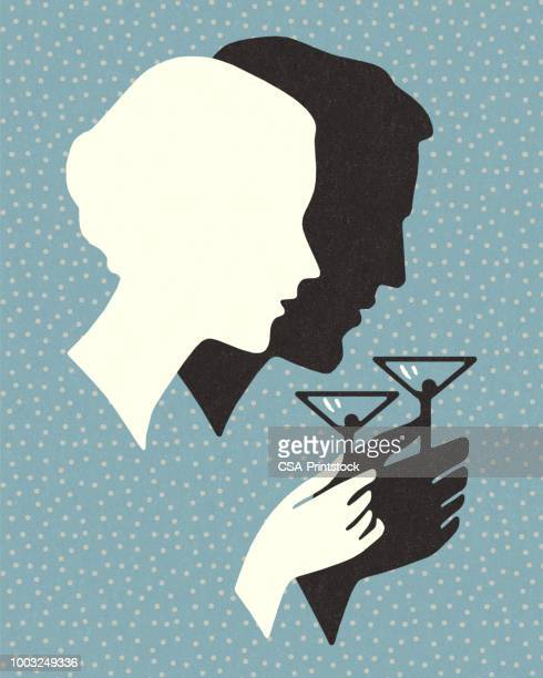 silhouette of a man and woman drinking a cocktail - martini stock illustrations