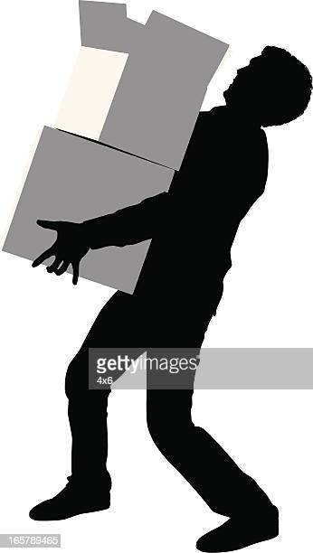 Silhouette of a man carrying cardboard boxes