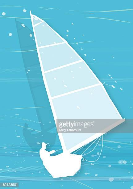 Silhouette of a man sailing a sailboat