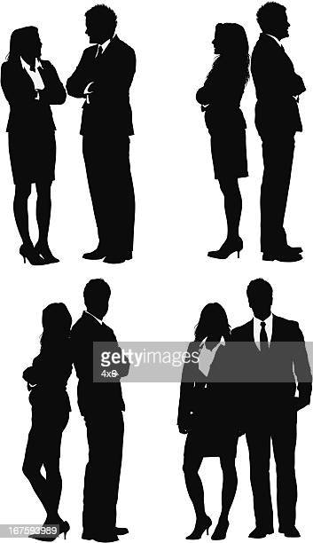 silhouette of business couple - back to back stock illustrations, clip art, cartoons, & icons
