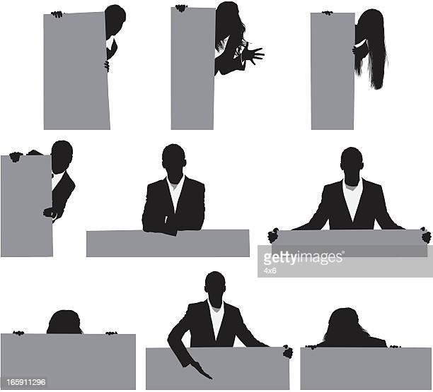 Silhouette of business executives with placards