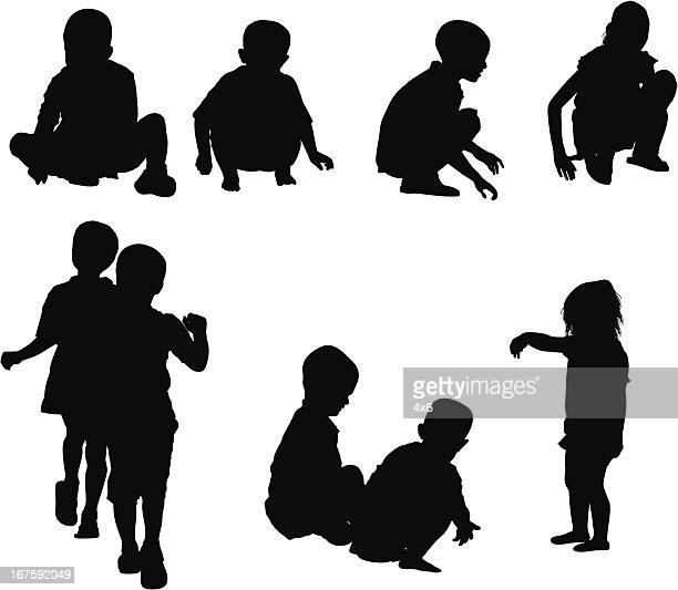 Silhouette of children playing