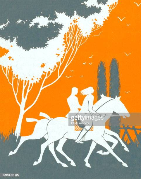 Silhouette of Couple Horseback Riding