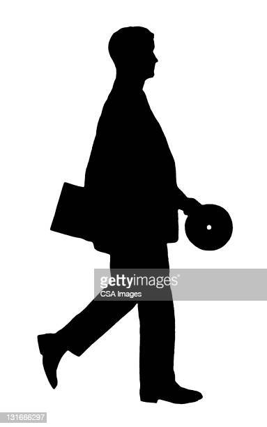 Silhouette of Man Carrying Record