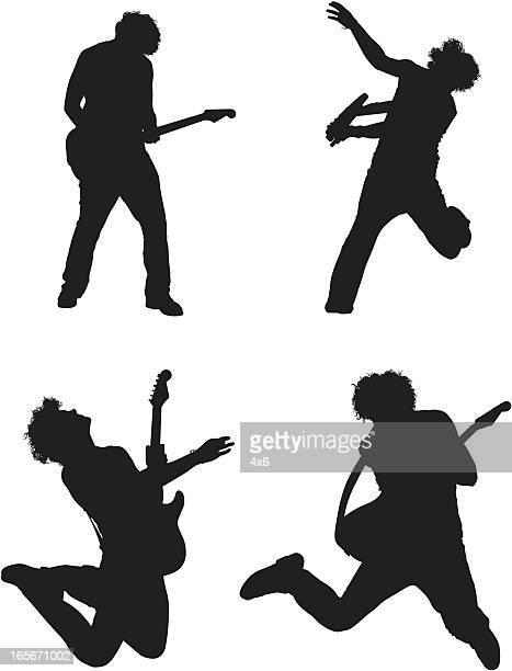 ilustraciones, imágenes clip art, dibujos animados e iconos de stock de silueta de hombre tocando la guitarra - bajo eléctrico