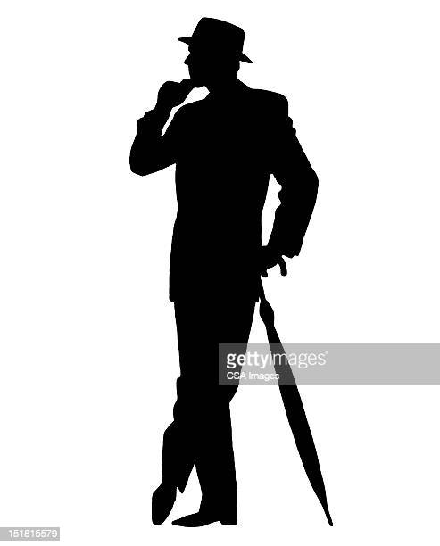 Silhouette of Man With Umbrella