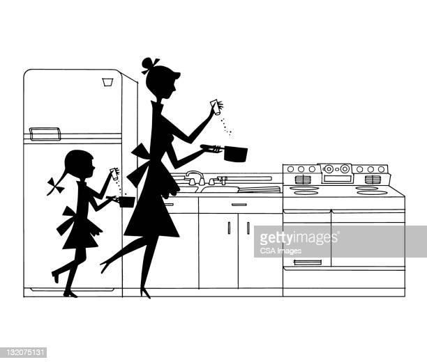 シルエットの母と娘の料理