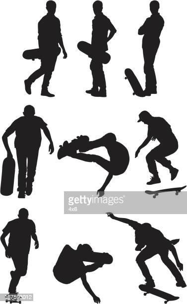 Silhouette von Menschen mit skateboards