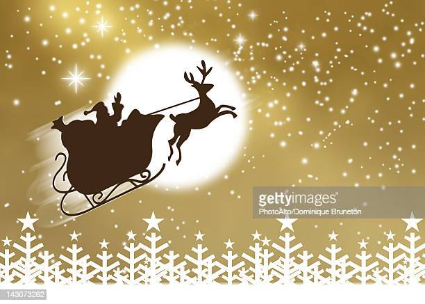 Silhouette of Santa Claus and his sleigh flying in nighttime sky