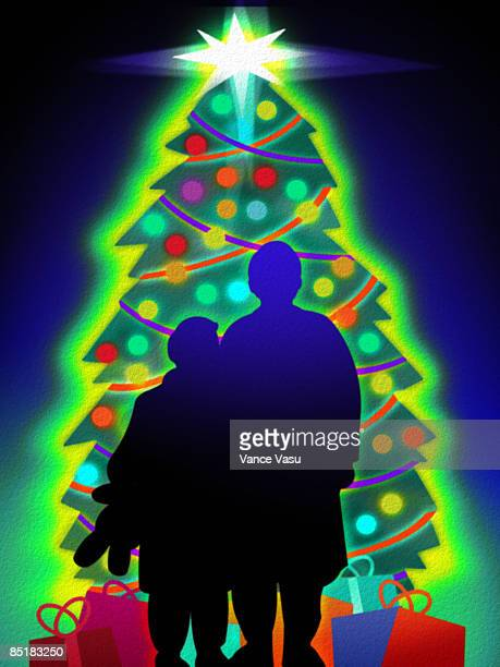 silhouette of two children standing in front of a glowing christmas tree and gifts - number of people stock illustrations, clip art, cartoons, & icons