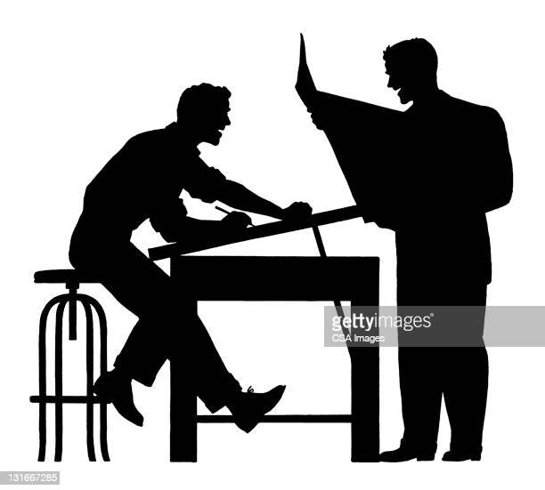 Silhouette of Two Men Working