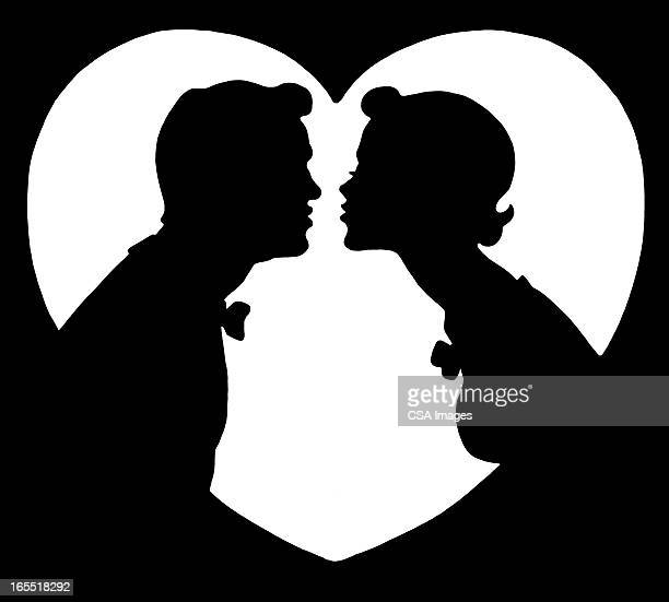 Silhouette of Two People Kissing
