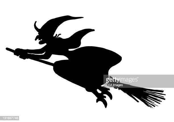silhouette of witch on broom - broom stock illustrations, clip art, cartoons, & icons