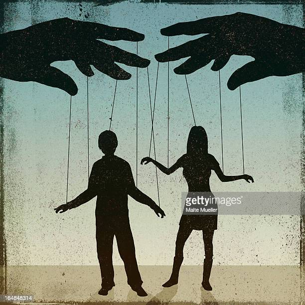 A silhouetted man and woman being controlled by a puppeteer
