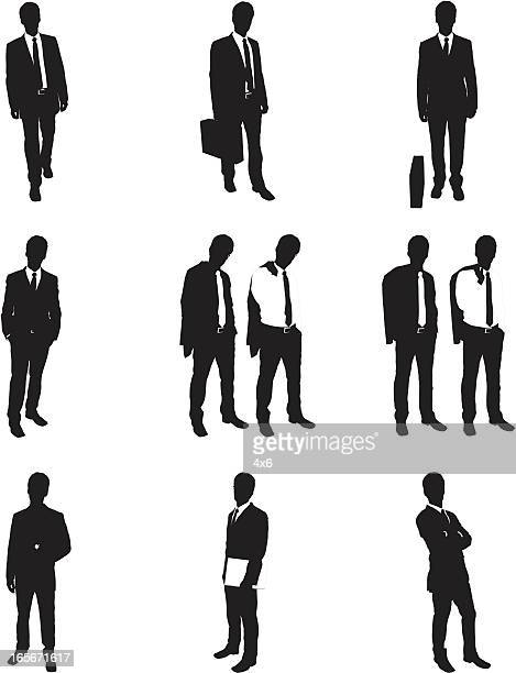 Silhouettes of businessman posing