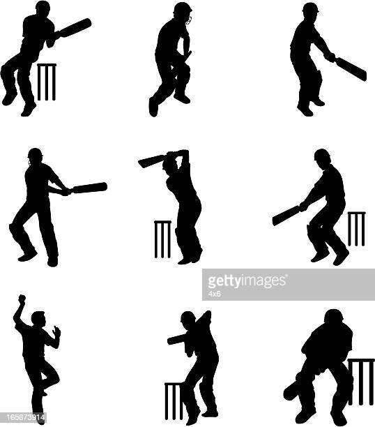 silhouettes of cricket batsmen at wicket (cartoon style) - wicket stock illustrations