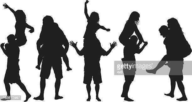 silhouettes of guy giving girl a piggy-back ride - piggyback stock illustrations, clip art, cartoons, & icons