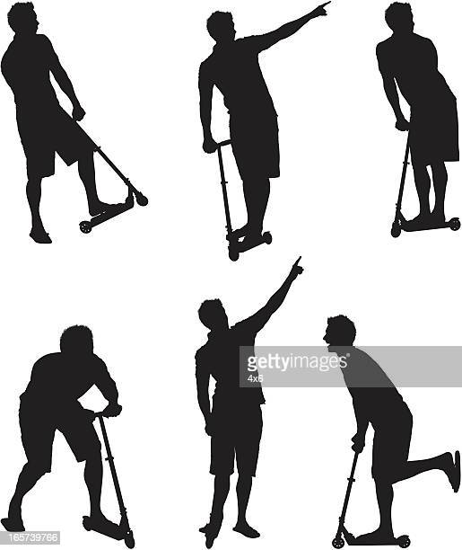 Silhouettes of men on push scooters