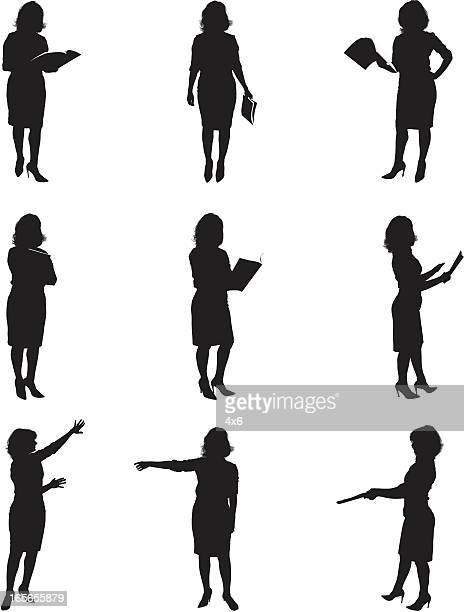 silhouettes of women reading - image technique stock illustrations