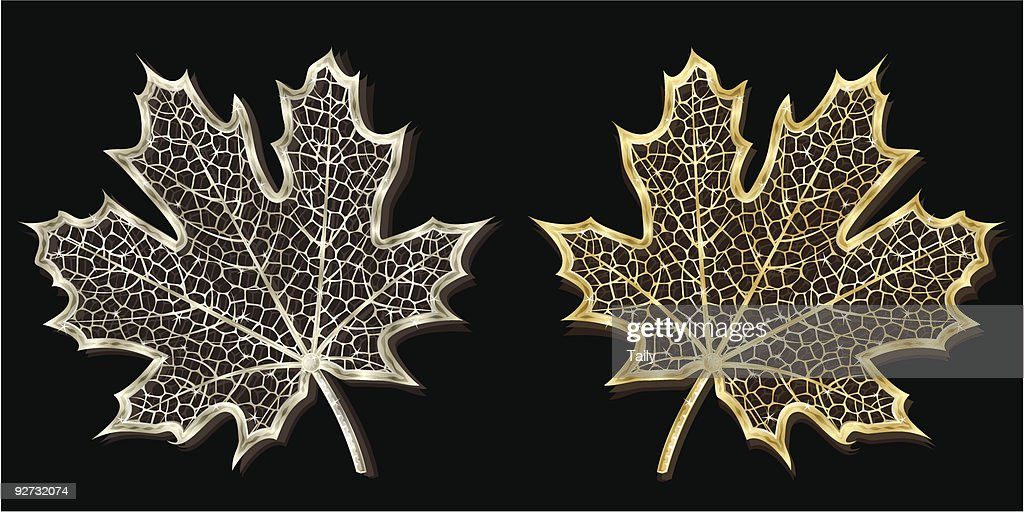 Silver and golden hand-made maple leaves