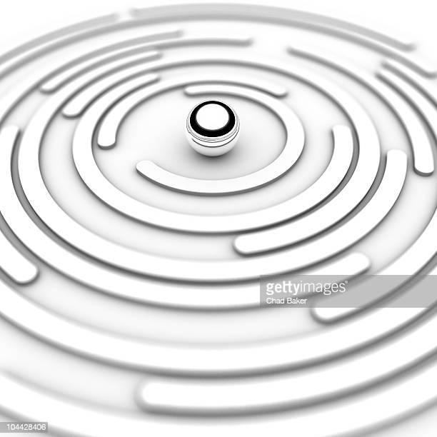 silver ball in circular maze - shiny stock illustrations