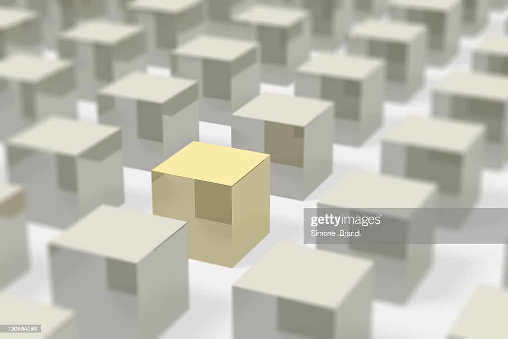Silver metal cubes in rows with bokeh, the focus is on a golden cube, concept picture, symbol for society, group, individual, uniqueness, 3D illustration : stock illustration