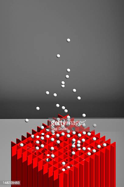 Simple composition with red object and a white bal