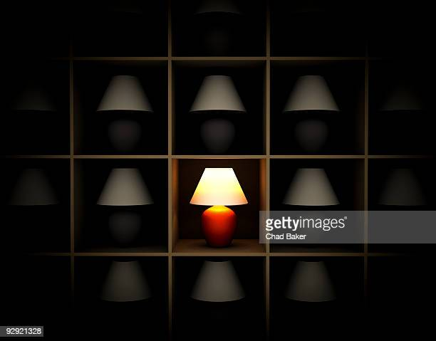 A single red lamp on a shelf