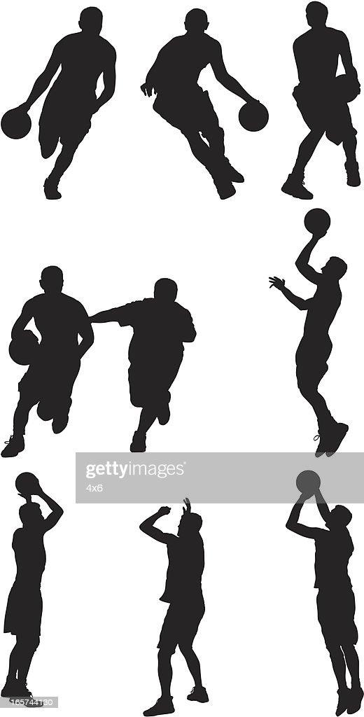 Skillful basketball players handling the ball