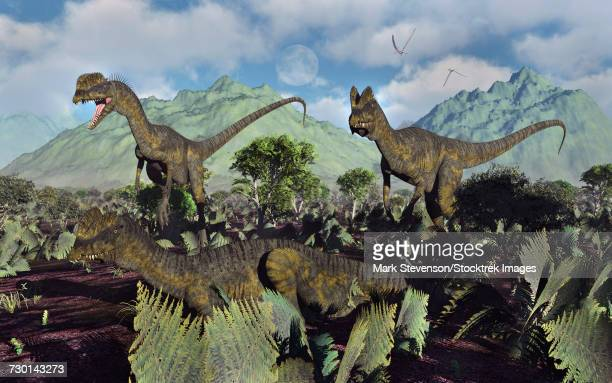 A small pack of Dilophosaurus dinosaurs during Earths Jurassic period.