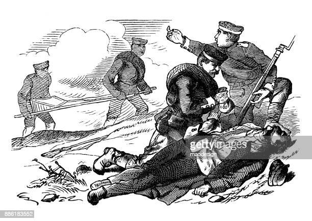 soldiers take care of a wounded man laying on the battlefield. - battlefield stock illustrations, clip art, cartoons, & icons