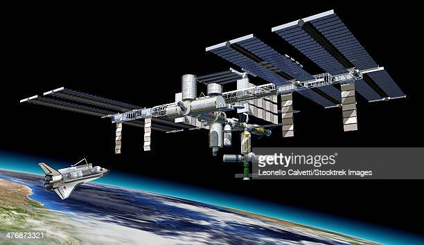 Space station in orbit around Earth with space shuttle.