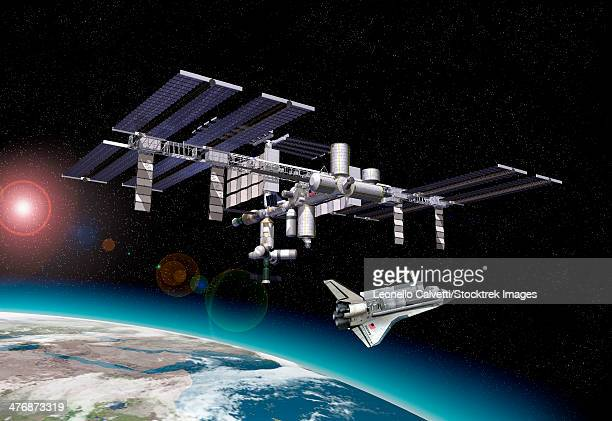 space station in orbit around earth with space shuttle. some starlight effects and a portion of the earth are visible at the bottom. - discovery stock illustrations, clip art, cartoons, & icons