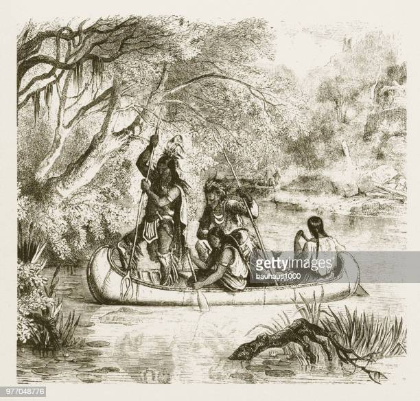 spear fishing from a canoe, american indians engraving, 1859 - indigenous north american culture stock illustrations, clip art, cartoons, & icons