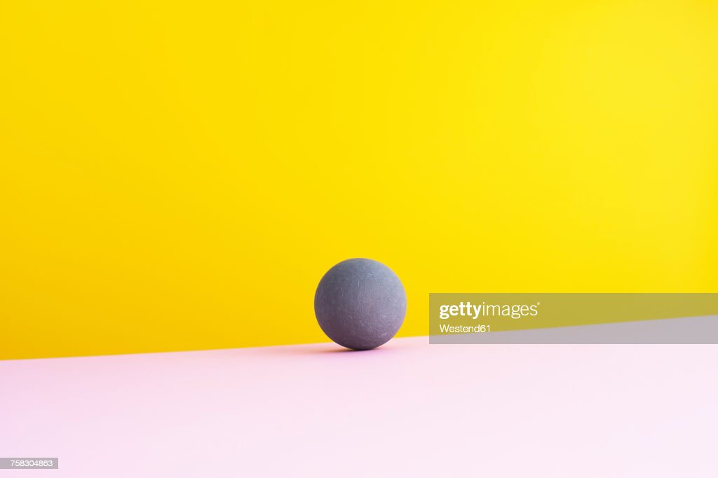 Sphere against yellow background, 3D Rendering : stock illustration