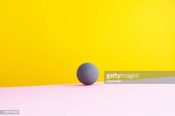 Sphere against yellow background, 3D Rendering