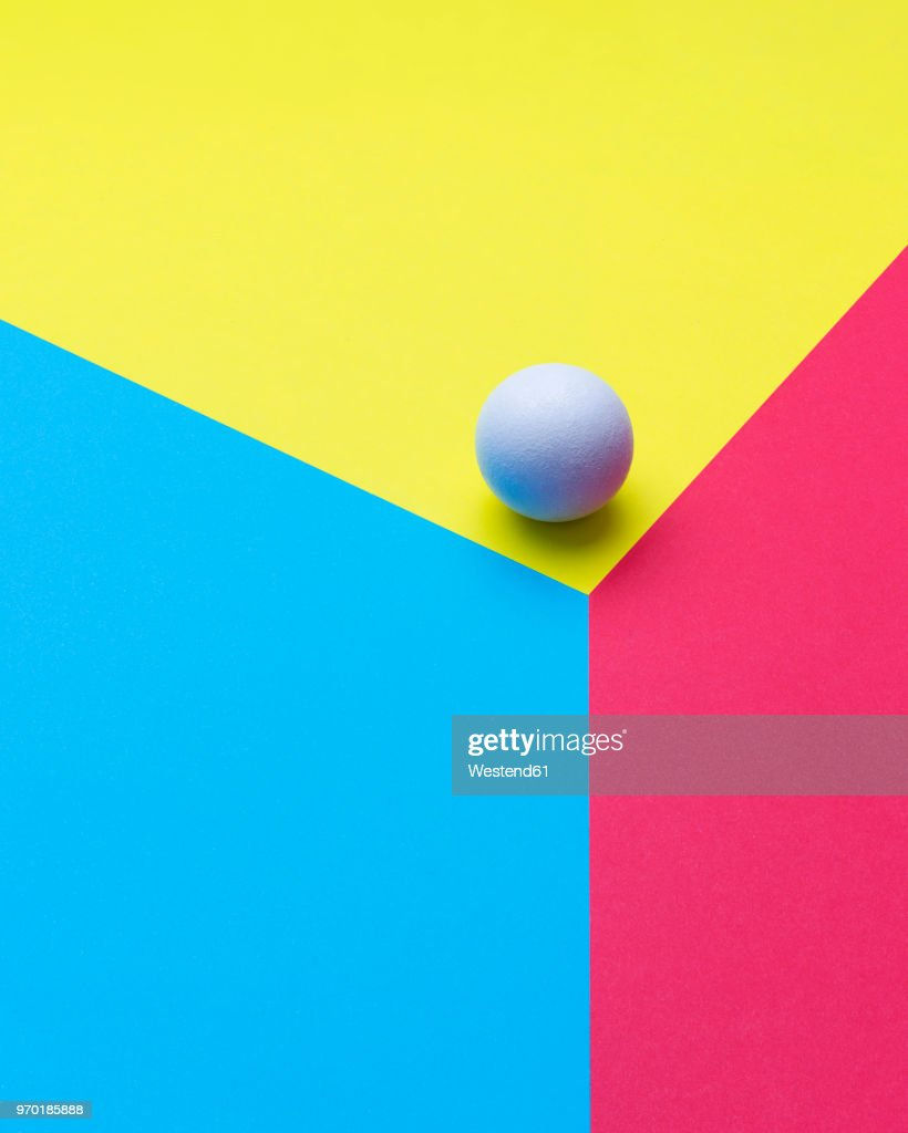 Sphere at the edge of a colorful cube : stock illustration