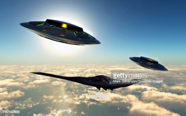 A B-2 Spirit stealth bomber being escorted by a pair of flying saucers.