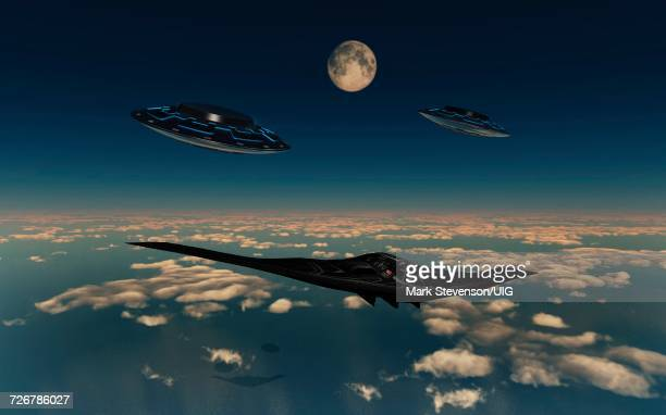 b-2 spirit stealth bomber being escorted by a pair of ufos - us air force stock illustrations, clip art, cartoons, & icons