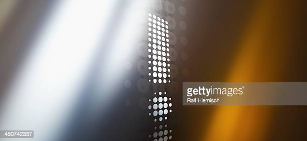 spotted exclamation mark against a background of colored light and shadow - exclamation mark stock illustrations