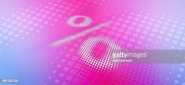 Spotted percentage sign against pink background