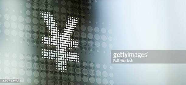 Spotted Yen sign reflected on abstract surface