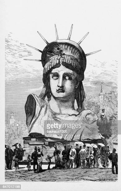 statue of liberty on display in paris victorian engraving, 1878 - statue of liberty new york city stock illustrations, clip art, cartoons, & icons
