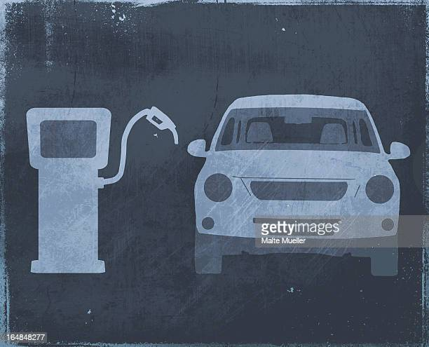 A stencil of a car next to a fuel pump