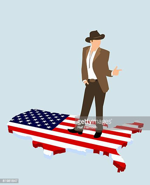a stereotypical american cowboy standing on the american flag in the shape of america - american culture stock illustrations