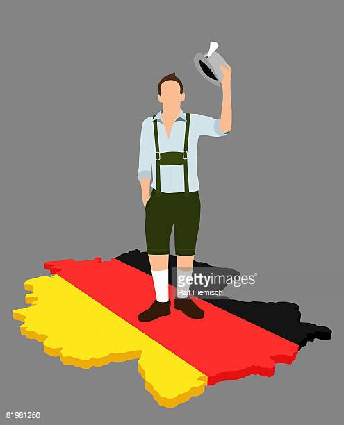 stereotypical german man standing on a german flag in the shape of germany - germany stock illustrations