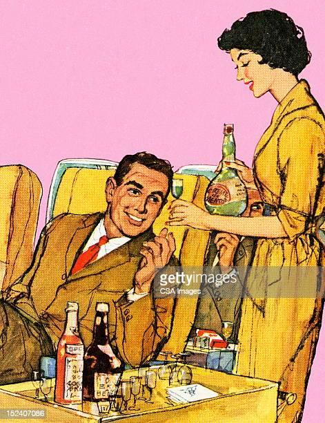 Stewardess Serving Drinks on Airplane