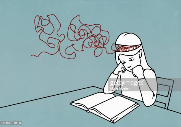 strings in brain of girl reading book - illustration stock illustrations