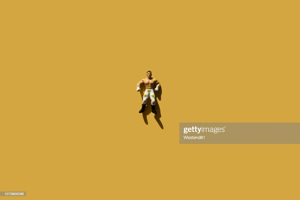 Strong man with green heart wrestler trousers and fake apples : stock illustration
